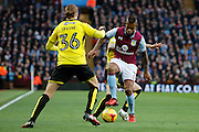 Aston Villa midfielder Leandro Bacuna (7) and Burton Albion midfielder Jackson Irvine (36) during the EFL Sky Bet Championship match between Aston Villa and Burton Albion at Villa Park, Birmingham, England on 26 December 2016. Photo by Richard Holmes.