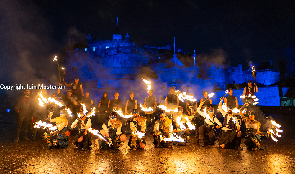 Edinburgh, Scotland, UK. 30th Dec 2019. Edinburgh's famous Hogmanay celebrations get under way with the Torchlight Procession along the historic Royal Mile in Edinburgh's Old Town and ending at Holyrood Park. The procession was led by the Celtic Fire Theatre company, PyroCeltica and the Harbinger Drum Crew. Pictured. Artists perform on Edinburgh Castle esplanade before the procession. Iain Masterton/Alamy Live News