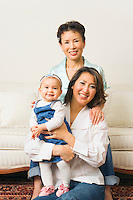 Portrait of mother with daughter and infant granddaughter.