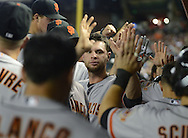 PHOENIX, AZ - JUNE 08:  Infielder Brandon Belt #9 of the San Francisco Giants celebrates with teammates during the game against the Arizona Diamondbacks Chase Field on June 8, 2013 in Phoenix, Arizona. The Giants defeated the Diamondbacks 10-5.  (Photo by Jennifer Stewart/Getty Images)