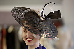 © Licensed to London News Pictures. 25/06/2012. LONDON, UK. A member of staff at Kerry Taylor Auctions models a hat designed by Philip Somerville and previously worn by Kate Middleton on the occasion of H.R.H. Prince William being awarded the Order of the Garter. The hat is being sold as part of an auction of over 250 lots of fine haute couture, accessories and textiles and is expected to fetch £1000 - 1,500. Photo credit: Matt Cetti-Roberts/LNP