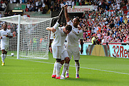 Swansea city's Wayne Routledge ® celebrates with Danny Graham © and Nathan Dyer (l) after he scores his sides 1st goal. Barclays Premier league, Swansea city v Sunderland at the Liberty Stadium in Swansea, South Wales on Saturday 1st Sept 2012. pic by Andrew Orchard, Andrew Orchard sports photography,