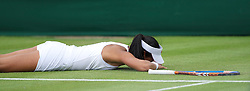 LONDON, ENGLAND - Tuesday, June 21, 2011: Anne Keothavong (GBR) is floored after diving for a shot during the Ladies' Singles 1st Round on day two of the Wimbledon Lawn Tennis Championships at the All England Lawn Tennis and Croquet Club. (Pic by David Rawcliffe/Propaganda)