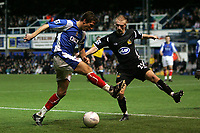 Photo: Lee Earle.<br /> Portsmouth v Wigan Athletic. The FA Cup. 06/01/2007. Portsmouth's Gary O'Neil (L) and Wigan's David Cotterill.