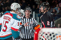 KELOWNA, CANADA - DECEMBER 30: Adam Griffiths, referee, gets between Tomas Soustal #15 of Kelowna Rockets and Sam Ruopp #2 of Prince George Cougars on December 30, 2014 at Prospera Place in Kelowna, British Columbia, Canada.  (Photo by Marissa Baecker/Shoot the Breeze)  *** Local Caption *** Adam Griffiths; Tomas Soustal; Sam Ruopp;