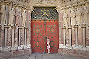 A young Czech girl visiting a historical convent with an elaborately decorated entrance - Porta Coeli in town of Predklasteri (Moravia region).