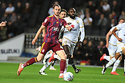 Ipswich Town forward Will Keane (48) looks to release the ball during the EFL Sky Bet League 1 match between Milton Keynes Dons and Ipswich Town at stadium:mk, Milton Keynes, England on 17 September 2019.