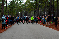 January 19, 2019 - Southern Pines, North Carolina, US - Jan. 19, 2019 - Southern Pines N.C., USA - Ultra marathon runners start the 10th Annual Weymouth Woods 100km ultra marathon at the Weymouth Woods Nature Preserve. Runners needed to complete 14 laps of the 4.47 mile course for 62.58 miles in under the 20-hour time allotment. (Credit Image: © Timothy L. Hale/ZUMA Wire)