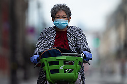 Cyclist wearing facemask and gloves ride bike on Rivoli Street in Paris on May 4, 2020, on the forty-ninth day of a strict lockdown in France, in place to attempt to stop the spread of the new coronavirus (COVID-19). Photo by Raphael Lafargue/ABACAPRESS.COM