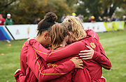 Oct. 27, 2017; Springfield, OR, USA; Southern California Trojans runners embrace prior to the women's race in the Pac-12 cross country championshipsat the Springfield  Golf Club.