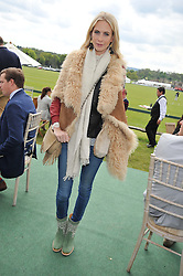 POPPY DELEVINGNE at the St.Regis International Polo Cup between England and South America held at Cowdray Park, West Sussex on 18th May 2013.  South America won by 11 goals to 9 goals.