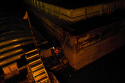 Trumbull River Service towboat deckhand working the night shift on the Illinois River. ©David Zalaznik