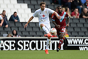 Milton Keynes Dons defender Joe Walsh (4) looks to release the ball  during the EFL Sky Bet League 1 match between Milton Keynes Dons and Port Vale at stadium:mk, Milton Keynes, England on 9 October 2016. Photo by Dennis Goodwin.