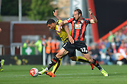 AFC Bournemouth's striker Glenn Murray tackles Watford FC captain, striker Troy Deener during the Barclays Premier League match between Bournemouth and Watford at the Goldsands Stadium, Bournemouth, England on 3 October 2015. Photo by Mark Davies.
