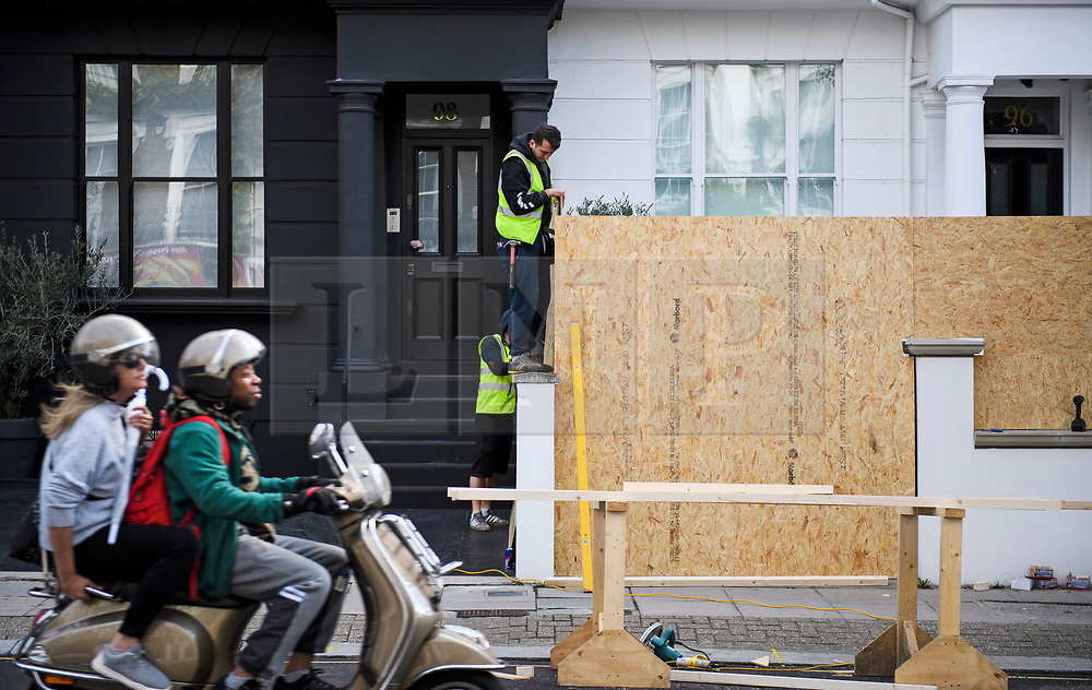 © Licensed to London News Pictures. 25/08/2018. London, UK. A residential property in Notting Hill being boarded up by workmen, ahead of the 2018 Notting Hill Carnival which starts tomorrow (Sunday). Up to 1 million people are expected to attend this weekend's event that is one of the worlds largest street festivals. Photo credit: Ben Cawthra/LNP