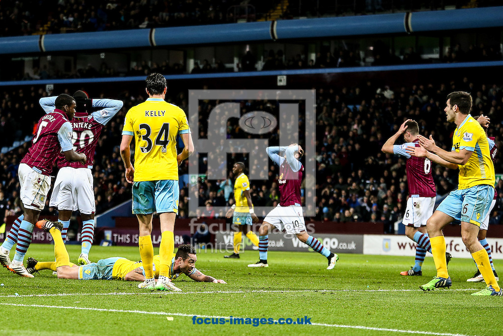 Aston Villa players rue another near miss during the Barclays Premier League match at Villa Park, Birmingham<br /> Picture by Andy Kearns/Focus Images Ltd 0781 864 4264<br /> 01/01/2015