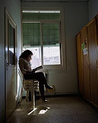 Barcelona, Spain. Reading in Spanish prison. Rosalinda, mexican, in her cell from Women Prison Wad Ras. She did not read before entering prison. Now, she reads books that help her to fit her new situation.©Carmen Secanella