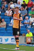 Hull City midfielder Sam Clucas prepares to take a throw during the Sky Bet Championship match between Brighton and Hove Albion and Hull City at the American Express Community Stadium, Brighton and Hove, England on 12 September 2015. Photo by Bennett Dean.