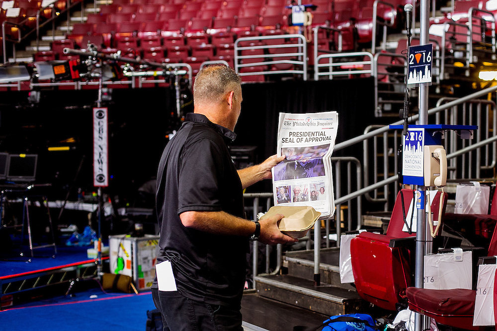 PHILADELPHIA, PA - JULY  28, 2016: A stagehand reads the Philadelphia Enquirer before the final night of the Democratic National Convention in Philadelphia, Pennsylvania. CREDIT: Sam Hodgson for The New York Times. <br /> <br /> NYTDNC