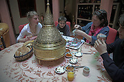 Model released image of family having breakfast, Marrakech, Morocco