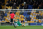 Mansfield Town goalkeeper Conrad Logan (1) saves during the EFL Sky Bet League 2 match between Mansfield Town and Grimsby Town FC at the One Call Stadium, Mansfield, England on 4 January 2020.