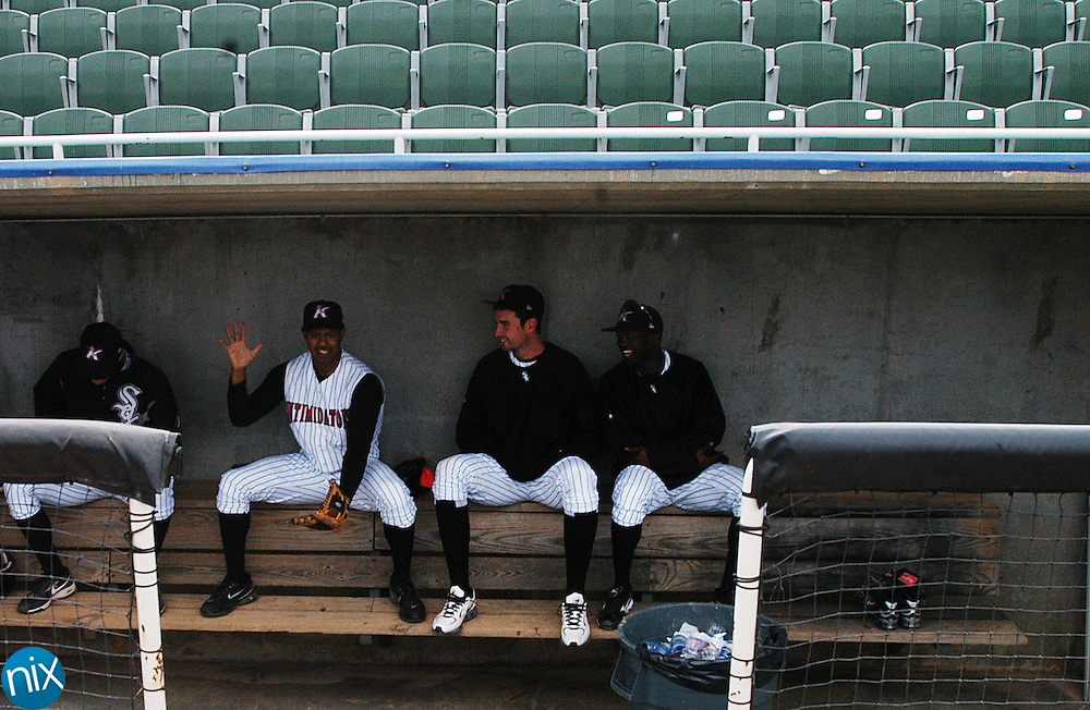 Kannapolis Intimidator outfielder Jordan Cheatham, left, jokes with teammates Garrett Johnson and Justin Greene while waiting in the dugout during media day at Fieldcrest Cannon Stadium Tuesday afternoon.