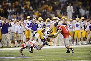 LSU's Earl Doucet holds on to a first down despite be upended by Donald Washington, left, and Marcus Freeman of Ohio State in the first quarter. The Tigers defeated Ohio State 38-24 for the BCS National Championship..#1 Ohio State battled #2 LSU in the BCS National Championship Game at the Superdome in New Orleans, Jan. 7, 2008.
