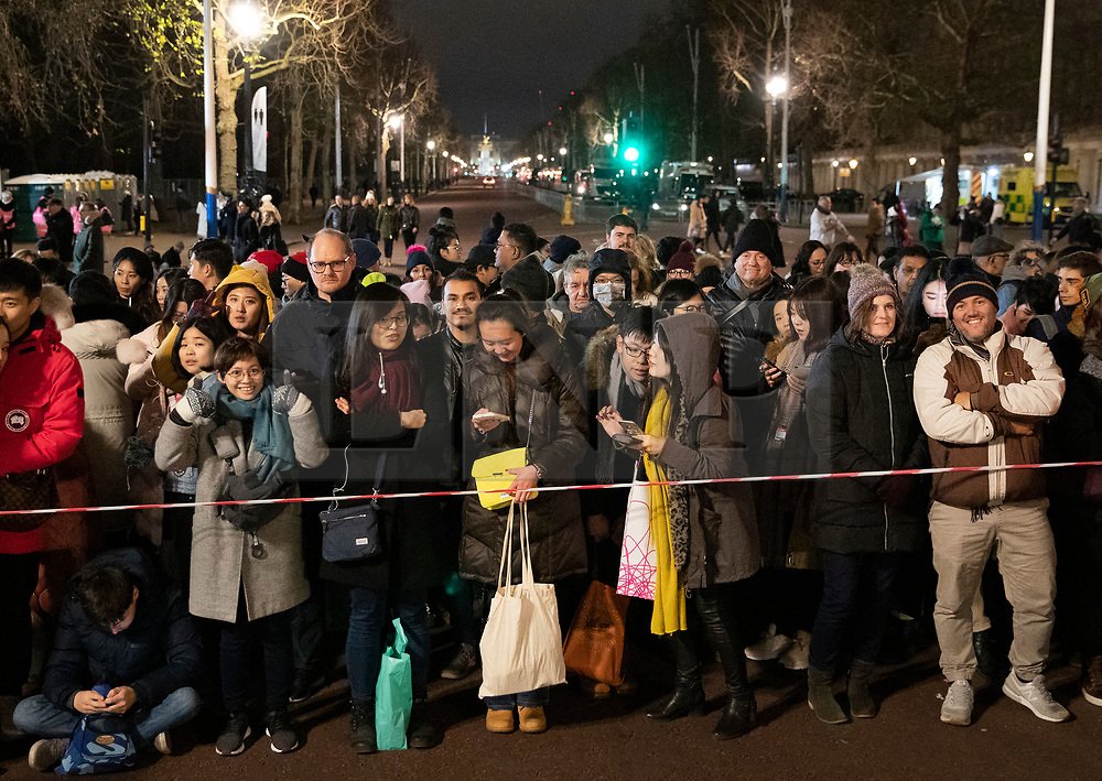 © Licensed to London News Pictures. 31/12/2018. London, UK. Crowds wait on The Mall before going through a security check as they arrive to celebrate New Year's Eve in central London.  Over 100,000 people are attending London's ticketed fireworks display on the banks of the River Thames for New Year's Eve tonight. Photo credit: Peter Macdiarmid/LNP
