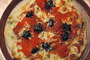 Leaf-footed bug pizza prepared by entomologist Julieta Ramos-Elorduy for her son Ernesto, hungry from an extended session of college homework. This is Ernesto's favorite dish. Mexico City, Mexico. Image from the book project Man Eating Bugs: The Art and Science of Eating Insects.
