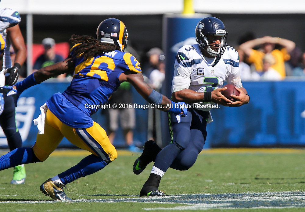 Seattle Seahawks quarterback Russell Wilson (3) is defender  by Los Angeles Rams outside linebacker Mark Barron (26) during a NFL football game, Sunday, Sept. 18, 2016, in Los Angeles. The Rams won 9-3. (Photo by Ringo Chiu/PHOTOFORMULA.com)<br /> <br /> Usage Notes: This content is intended for editorial use only. For other uses, additional clearances may be required.