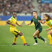 GRENOBLE, FRANCE June 18.  Chloe Logarzo #6 of Australia defended by Toriana Patterson #19 of Jamaica and Tiffany Cameron #15 of Jamaica during the Jamaica V Australia, Group C match at the FIFA Women's World Cup at Stade des Alpes on June 18th 2019 in Grenoble, France. (Photo by Tim Clayton/Corbis via Getty Images)