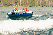 Brothers laugh and smile while tubbing on Red Fish Lake, Stanley, Idaho. MR