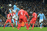 Manchester City defender Eliaquim Mangala attacks the cross during the Champions League Group D match between Manchester City and Sevilla at the Etihad Stadium, Manchester, England on 21 October 2015. Photo by Alan Franklin.