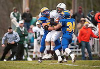Ben Gambino and Oliver Gallo of Kearsarge tackle Monadnock's Dylan Bell Saturday night during NHIAA Division V semi final football matchup.   (Karen Bobotas/for the Concord Monitor)