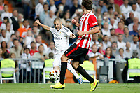 Karim Benzema of Real Madrid and Gurpegui of Athletic de Bilbao during La Liga match between Real Madrid and Athletic de Bilbao at Santiago Bernabeu stadium in Madrid, Spain. October 05, 2014. (ALTERPHOTOS/Caro Marin)