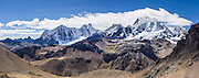 Yerupaja Grande (6635 m or 21,770 ft) is Peru's second highest peak. Center left is Mount Jirishanca (Icy Beak of the Hummingbird, 6126 m or 20,098 feet). Day 8 of 9 days trekking around the Cordillera Huayhuash in the Andes Mountains, LLamac, Peru, South America. This panorama was stitched from 4 overlapping photos.