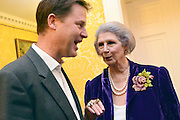 © Licensed to London News Pictures. 11/09/2013. London, UK Nick Clegg talks with April Ashley, MBE, a transgender model and restaurant hostess. The Deputy Prime Minister, Nick Clegg, hosts a reception at Admiralty House in Whitehall this evening, 11 September 2013, to celebrate the government's progress in equal marriage. From next year gay people will be able to get married. A number of high profile guests including openly supportive celebrities, campaigners, religious figures and charities were in attendance.<br /> The London Gay Men Chorus Ensemble performed at the event. . Photo credit : Stephen Simpson/LNP