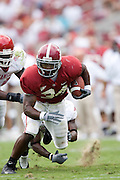 Alabama Crimson Tide running back Kenneth Darby avoids a tackle during a 24 to 13 win over the Arkansas Razorbacks on September 24, 2005 at Bryant-Denny Stadium in Tuscaloosa, Alabama..Mandatory Credit: Wesley Hitt/Icon SMI