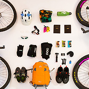 Jay Goodrich's mountain biking equipment laid out on white seamless.
