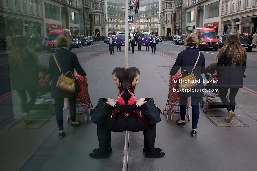 Mothers and children and symmetrical reflection of street woman, waiting for City of London bus.