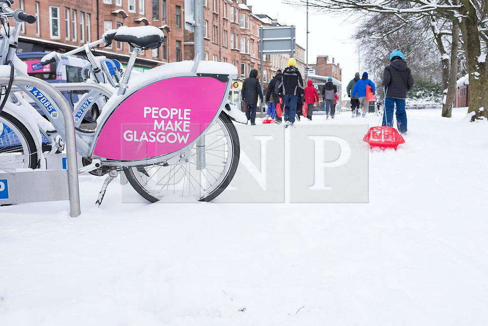 """© Licensed to London News Pictures. 28/02/2018. <br /> <br /> A child takes a sled to the park in Glasgow, Scotland as the city is hit with snow storm """"Beast from the East"""" on 28th February 2018.<br /> <br /> Photo credit should read Max Bryan/LNP"""