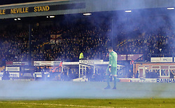 Blue smoke from a flare thrown from Bolton Wanderers fans lifts into sky around Ben Williams of Bury - Mandatory by-line: Robbie Stephenson/JMP - 24/10/2016 - FOOTBALL - Gigg Lane - Bury, England - Bury v Bolton Wanderers - Sky Bet League One