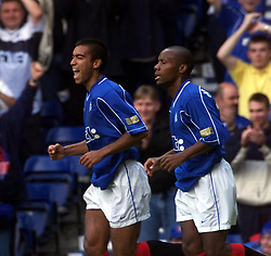Giovanni van Bronckhorst celebrates after scoring their second goal, during a Rangers v Dunfermline game in August 2000..
