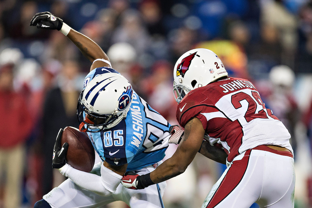NASHVILLE, TN - DECEMBER 15: Nate Washington #85 of the Tennessee Titans is tackled by Rashad Johnson #26 of the Arizona Cardinals at LP Field on December 15, 2013 in Nashville, Tennessee.  The Cardinals defeated the Titans 37-34.  (Photo by Wesley Hitt/Getty Images) *** Local Caption *** Nate Washington; Rashad Johnson