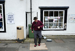 © Licensed to London News Pictures. <br /> 05/06/2014. <br /> <br /> Appleby, Cumbria, England<br /> <br /> A street entertainer dances an Irish jig as gypsies and travellers gather during the annual horse fair on 5 June, 2014 in Appleby, Cumbria. The event remains one of the largest and oldest events in Europe and gives the opportunity for travelling communities to meet friends, celebrate their music, folklore and to buy and sell horses.<br /> <br /> The event has existed under the protection of a charter granted by King James II in 1685 and it remains the most important event in the gypsy and traveller calendar.<br /> <br /> Photo credit : Ian Forsyth/LNP