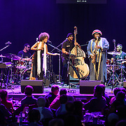 WASHINGTON, DC - August 26, 2015 - Cameron Graves, Tony Austin, Patrice Quinn, Miles Mosely, Kamasi Washington, Ronald Bruner and Ryan Porter perform at the Howard Theatre in Washington, D.C. After working with artists such as Kendrick Lamar and Flying Lotus, Washington is touring behind his debut studio album, The Epic.  (Photo by Kyle Gustafson / For The Washington Post)