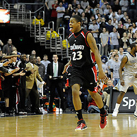 07 February 2009:   Cincinnati forward Alvin Mitchell (23) reacts after making a 3-point shot late in the 2nd half against the Georgetown University Hoyas at the Verizon Center in Washington, D.C.  The University of Cincinnati Bearcats defeated the Georgetown University Hoyas 64-62 in overtime.
