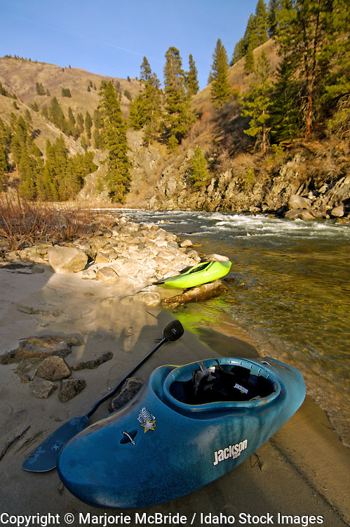 Kayaks along the bank of South Fork of the Payette River, Idaho.