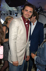 Singer DARIUS DANESH at the 2005 Cartier International Polo between England & Australia held at Guards Polo Club, Smith's Lawn, Windsor Great Park, Berkshire on 24th July 2005.<br />