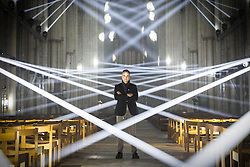 © Licensed to London News Pictures. 26/10/2016. York UK. Artist Jason Bruges stands in the middle of the York Minster nave at a preview of his art work, Light Masonry. The artwork has been installed as part of the Illuminating York festival & involves a light projection of 48 beams of light in a synchronised pattern within the nave of York Minster. Illuminating York runs from the 26th to the 29th of October Photo credit: Andrew McCaren/LNP